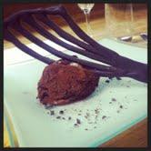 Ice cream truffle with rum-infused ganache.