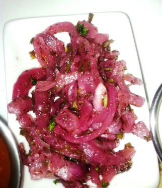 The sumac onion salad is a perfect floral-tart counterpoint to the spicy lamb.